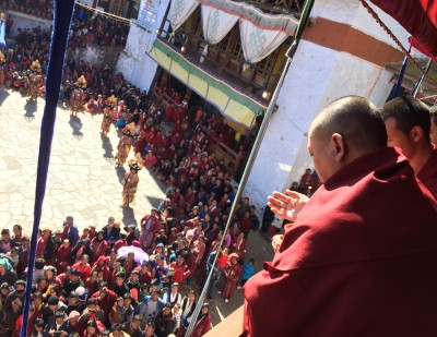 Abbot giving his blessings durin Cham at Torgya